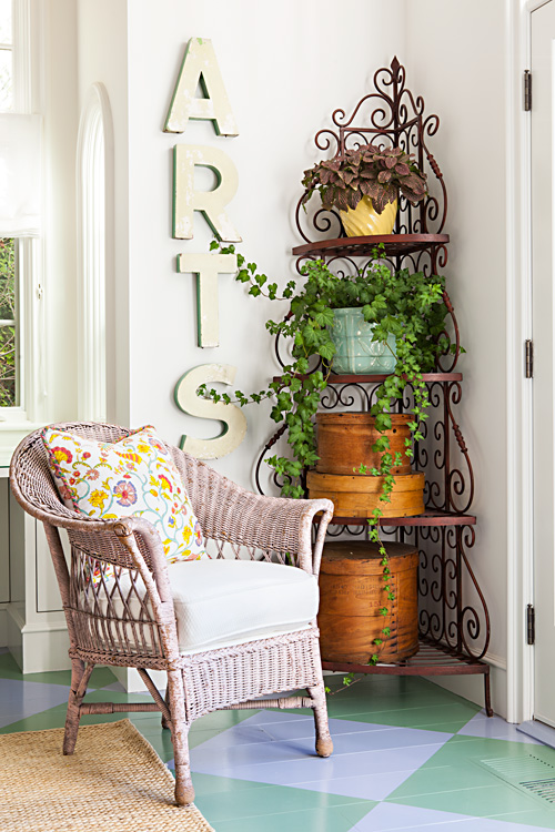 Wicker furniture and plenty of plants gives the interior of any beach cottage an outdoor feel.
