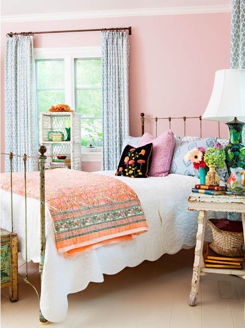 The hopeful colors and fun florals make this bedroom a place to recharge at the end of a long day.