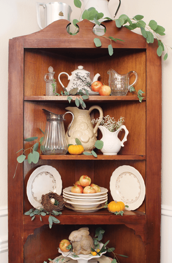 Look to your bookshelves, cabinets and display cases with an eye toward tucking in little seasonal surprises.