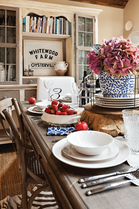 While Melaine often changes the furnishings in her house, her dining room table has been a constant. It's a classic base, and she can easily change the feel of the room with tableware and centerpieces.