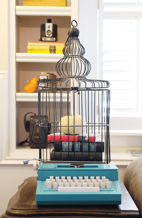 Look for unexpected places to spotlight a pumpkin, such as cupboards, birdcages or bookcases.