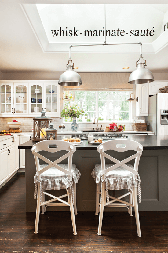 DIY pendant lights connected with pipe from a hardware store, shown here above the kitchen island.