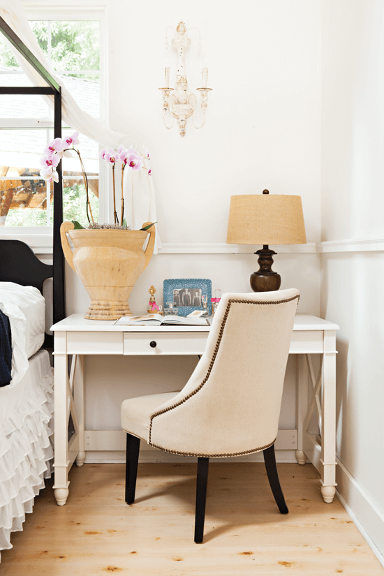 This upholstered desk chair adds a classic touch to the overall casual-chic room.