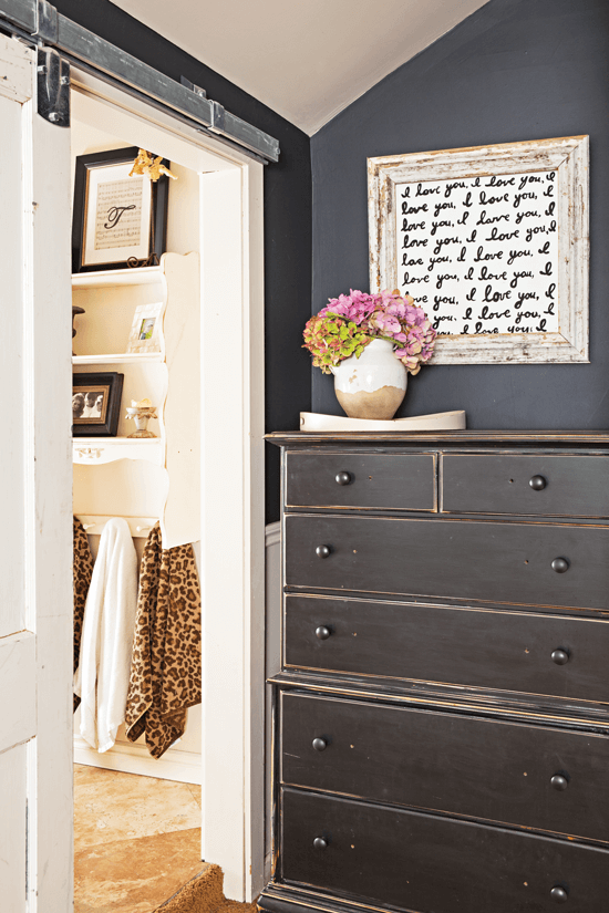 Refinished and distressed dresser that was created to tie in with the home's wood frames and barnyard glam touches.