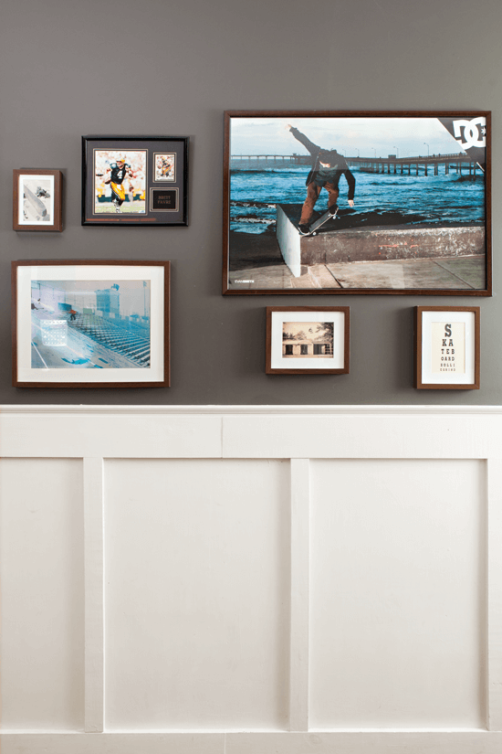 Gallery wall arranged in matching Ikea wood frames.