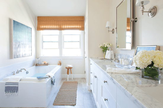 White marble, polished chrome and natural materials add a softness to the master bath in this beach cottage.