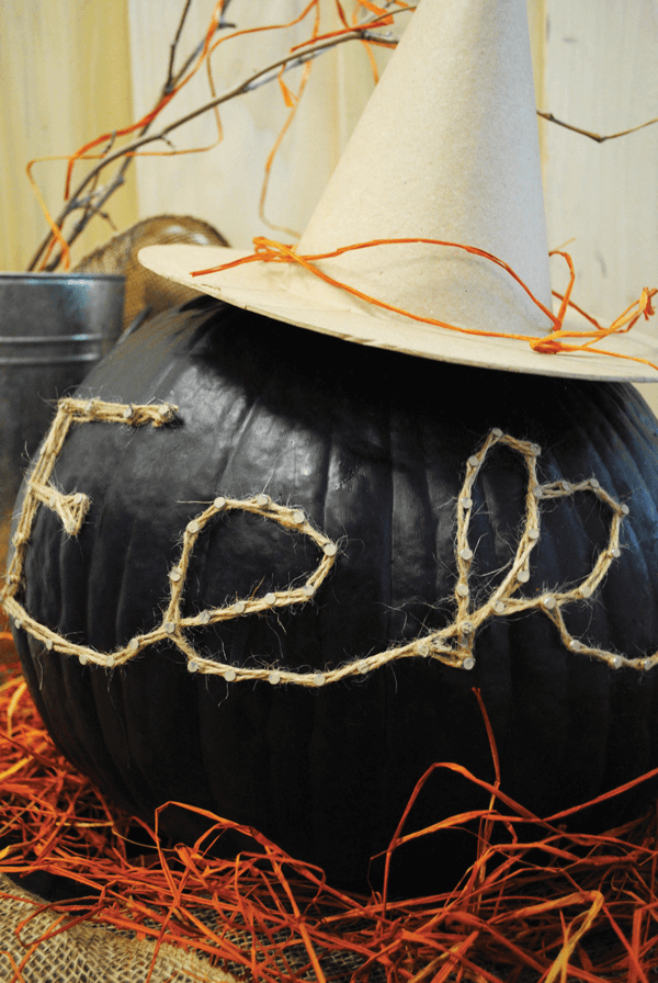 Create spooky sayings on your pumpkin using nails and twine.
