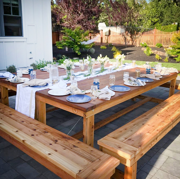 Large cedar table with matching wood benches.