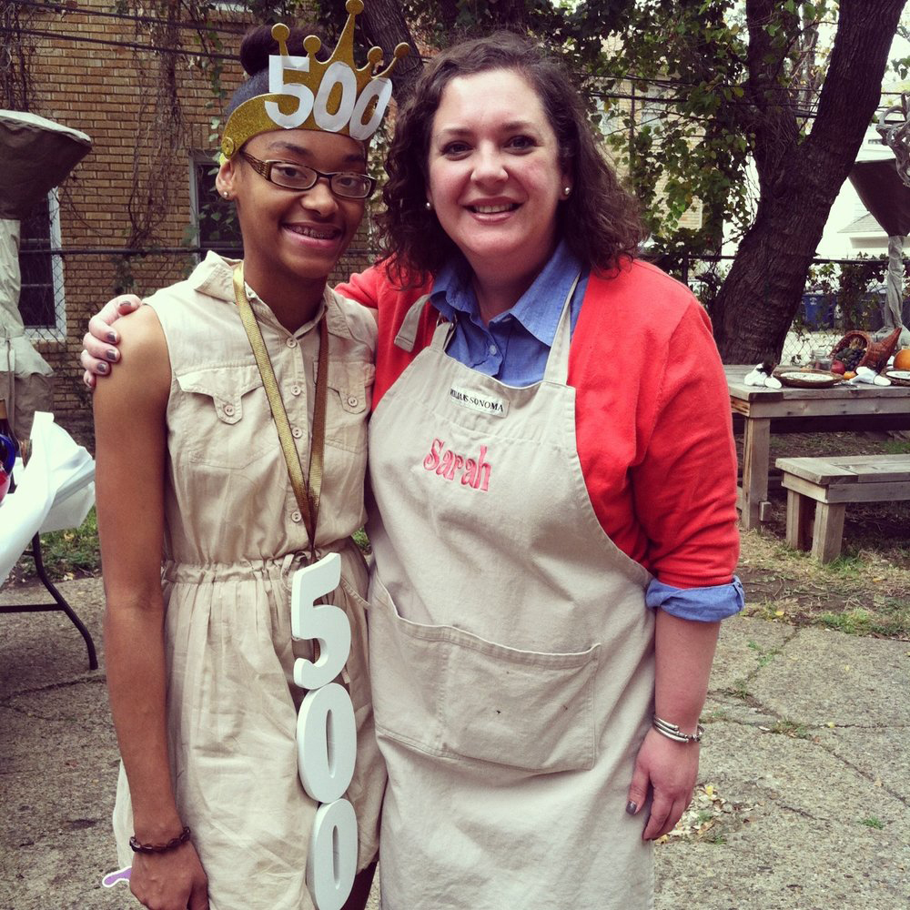Founder of Neighbor's Table, Sarah (right), pictured with her 500th guest (left), who she welcomed on Thanksgiving Day of 2012.