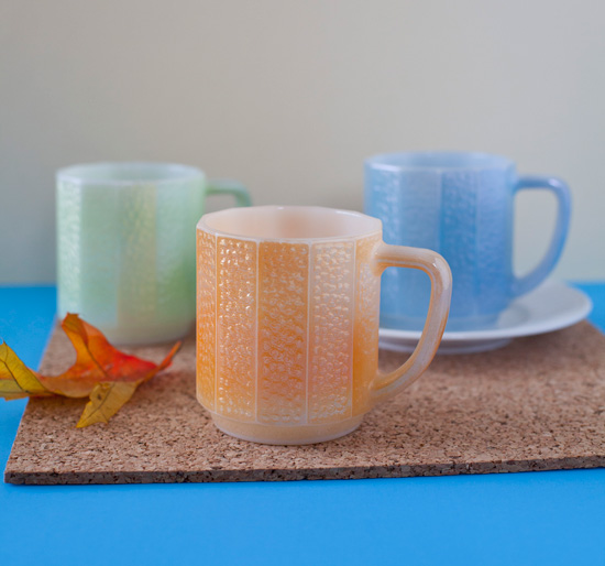 These simple, more minimally styled carnival glass mugs were made by the Federal Glass company around the late 1960s.