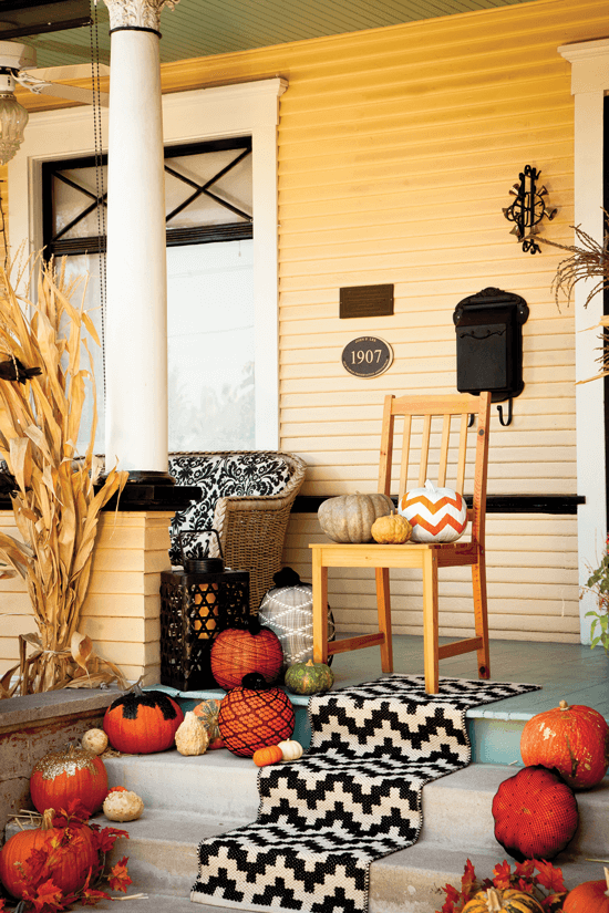 Don't be afraid to accessorize your Halloween porch with an indoor eye towards elegance and texture. Here, we added a graphic tribal-style runner to this Halloween porch décor.
