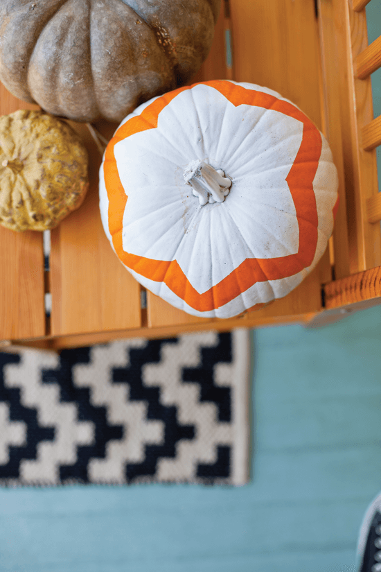 Our other favorite way to decorate pumpkins involves two easy ingredients: paint and painter's tape. Just mask off a pattern of your choice around your pumpkin, paint a few layers and then carefully peel off the tape to reveal your crisp design.