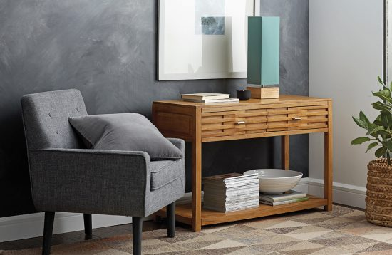 Add depth to gray rooms by using different shades of it—perhaps silver-gray walls with dark-gray furniture and accessories. Accessorize your room with the Tribeca Console, Angles Wool Rug, or Hues Mood Lamp from the Company Store, shown here.