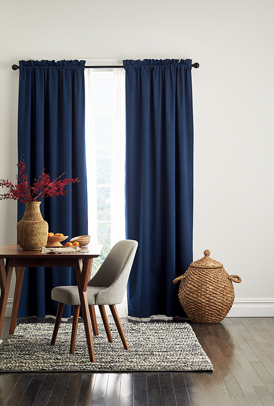 Room Darkening Window Panels from The Company Store, shown here in navy. They Block unwanted light, reduce noise, and insulate against heat and cold for reduced energy costs in summer and winter.