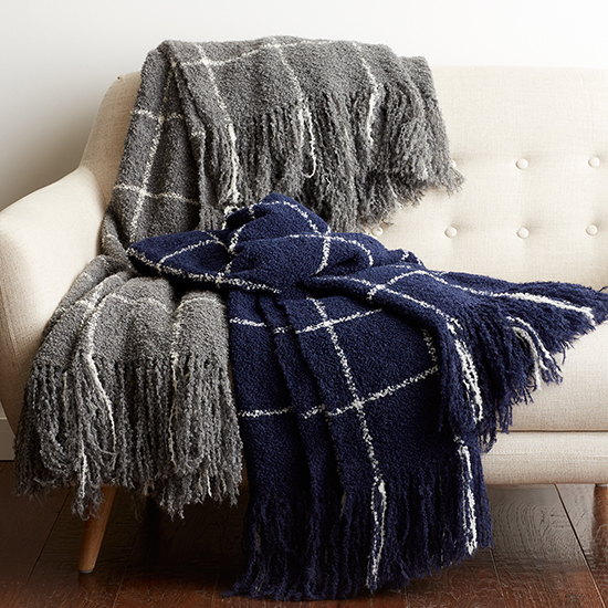 The Alpaca Bouclè Check Throw from The Company Store, shown here in navy and dark gray. These throw blankets are 100% yarn-dyed alpaca and luxuriously warm.
