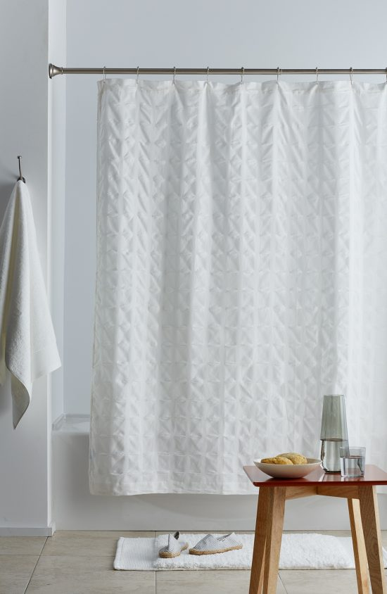 Organic Shower Curtain, Color Top Table, Organic Bath Rug, and Organic Cotton Towels from The Company Store, shown here.