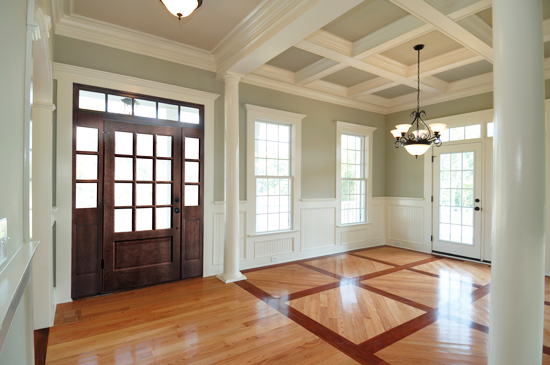 For a large space like this, having many architectural elements going on feels appropriate, while for a smaller space, a simpler treatment, such as just wainscoting, would work well.