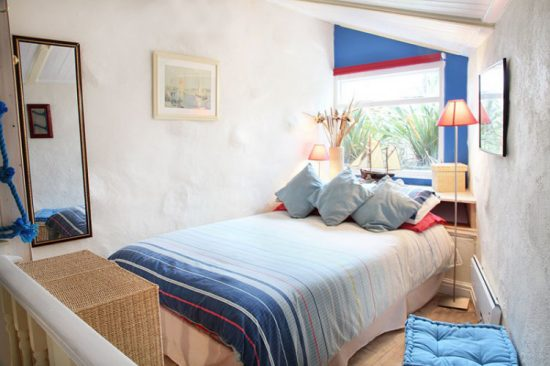 Oddly-shaped bedroom in the tiny cottage.