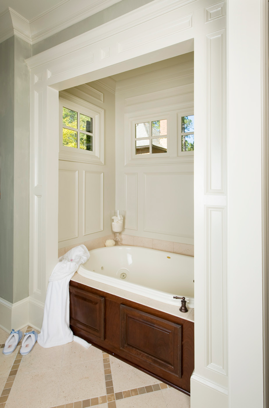 This master bathroom transformed into a showstopper with the addition of wainscoting surrounding the soaking tub.