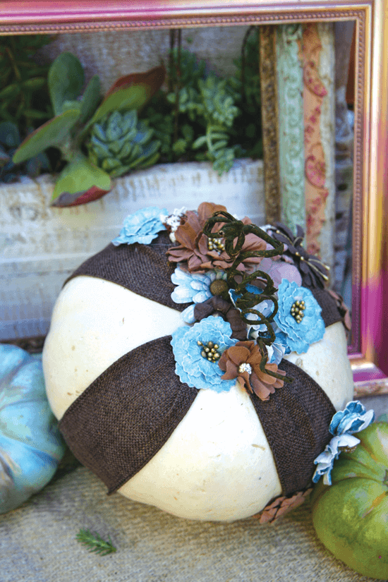 Wrapped in ribbon and fabric flowers, this pumpkin is transformed into a freestanding ornament.