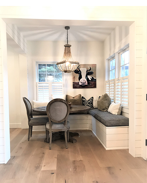 updated dining space with beautiful banquette seating and rustic touches