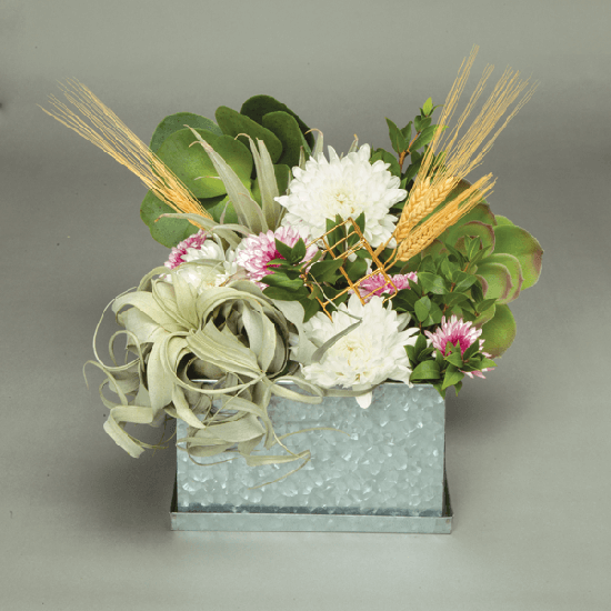 Add non-floral items to an arrangement for a centerpiece that breaks the mold in a beautiful way.
