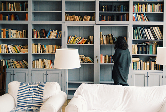 Book collection displayed on bookshelves