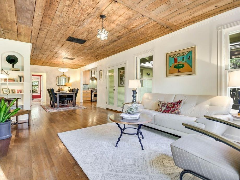 cottage with reclaimed ceiling