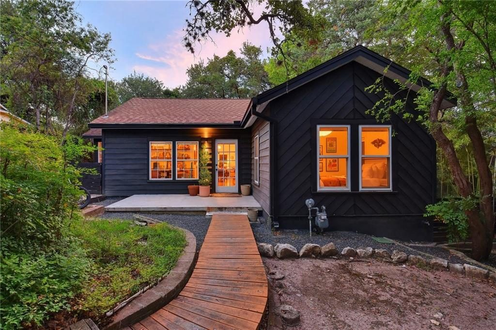 modern cottage with black paint