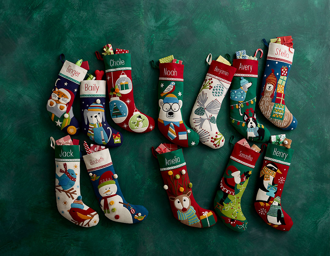 A collection of wool appliqué stockings by The Company Store