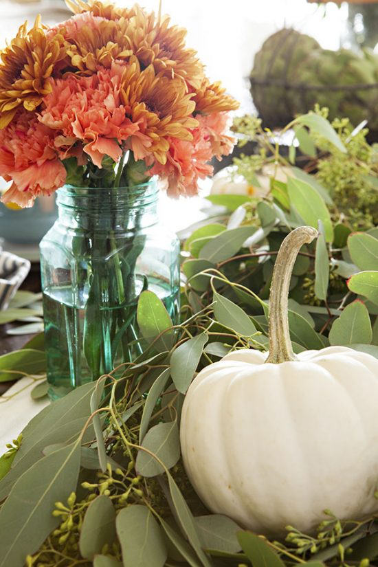 The bold floral color choices adds an inviting and warm feel to the table.