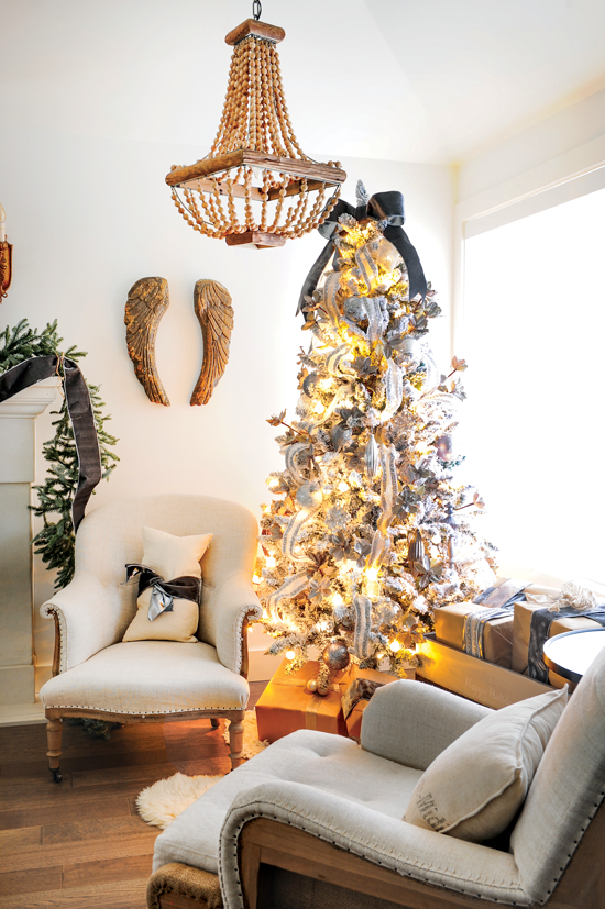 Sitting area with a pair of arm chairs and a beautiful pre-lit Christmas tree give this space a warm and cozy feel. // Cottages & Bungalows