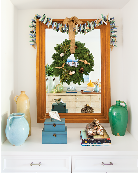 This hall mirror was turned into a work of art with driftwood garland and an earthy wreath.