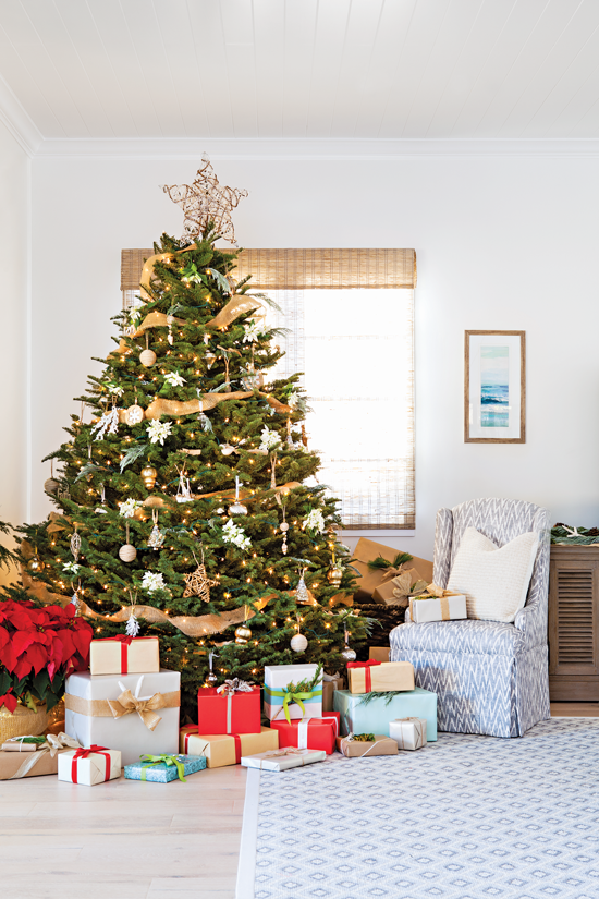 A large Christmas tree serves as the focal point of the living area in this modern beach cottage.