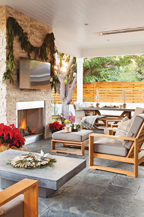Outdoor sitting area with fireplace and Christmas décor. // Cottages & Bungalows