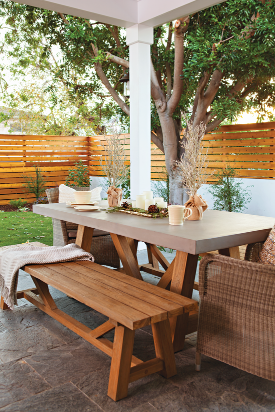 Outdoor picnic table with Christmas accent décor. // Cottages & Bungalows