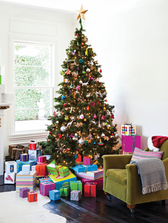 A colorfully-decorated Christmas tree and brightly-wrapped presents represents the expressive and unique personalities of each family member.