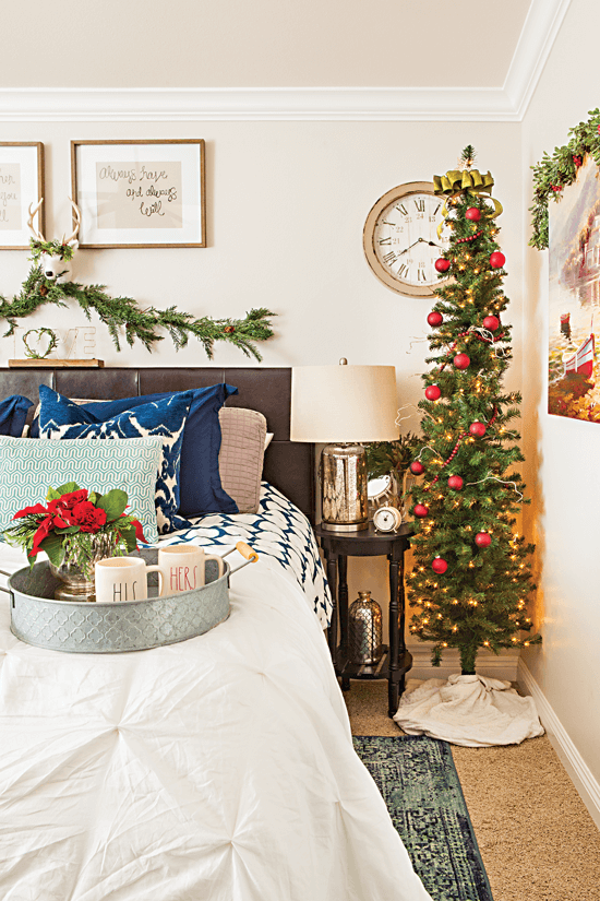 The red and green pieces of Christmas décor in this bedroom are accented with blue to give a lively and intriguing look. // Cottages & Bungalows