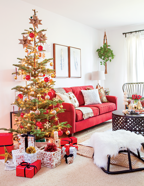 A peaceful living room marked by simplicity comes alive for the holidays, complete with a classic tree, gifts galore and a faux fur pelt.