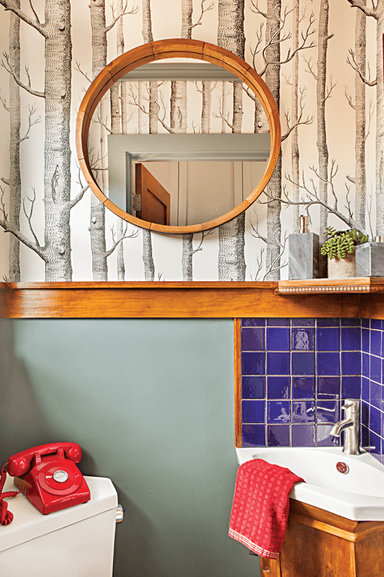 Small bathroom with birch tree wallpaper.