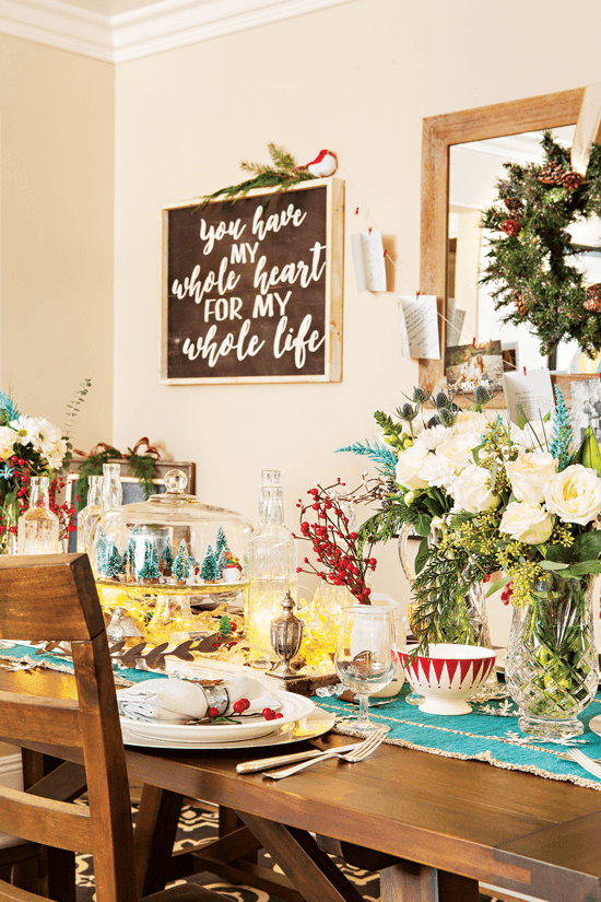 Vibrant aqua and pops of Rudolph-red give the table setting a merry and bright feel.