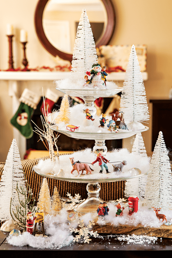 Pedestal plates stacked atop each other create a striking decorative focal point when transformed into a miniature wintry village