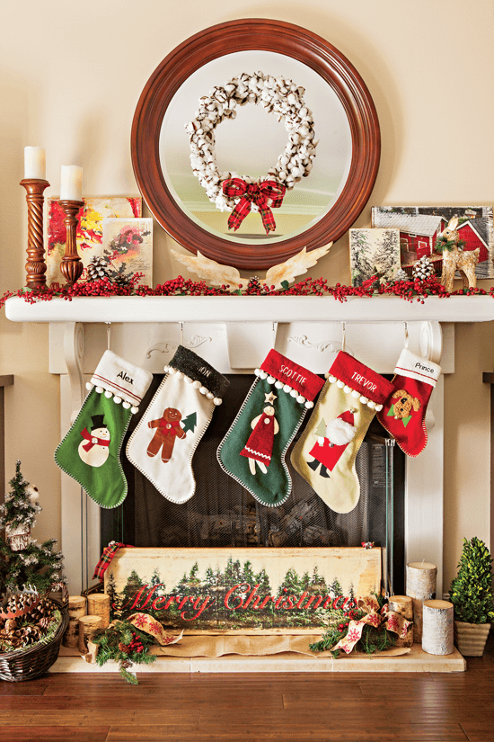"A cotton ball wreath coupled with a festive ribbon creates a rustic-cottage focal point for the mantel. Stockings are hung from the mantel and a ""Merry Christmas"" sign is displayed below."