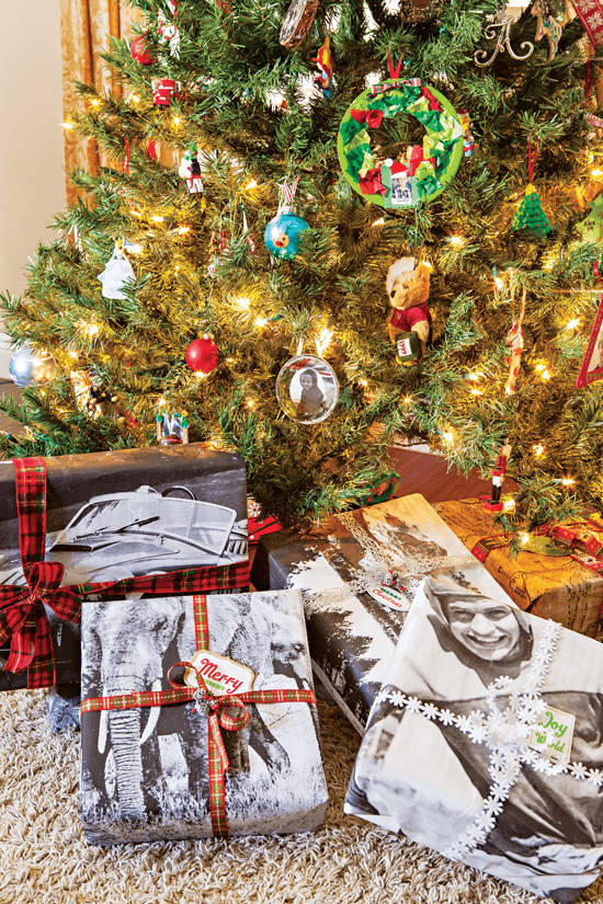 A unique way to wrap presents is to have engineering prints of your favorite family photos made at your local copier.