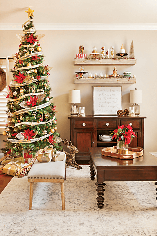 Living room area featuring an elegantly-decorated Christmas tree adorned with red and gold accents. // Cottages & Bungalows