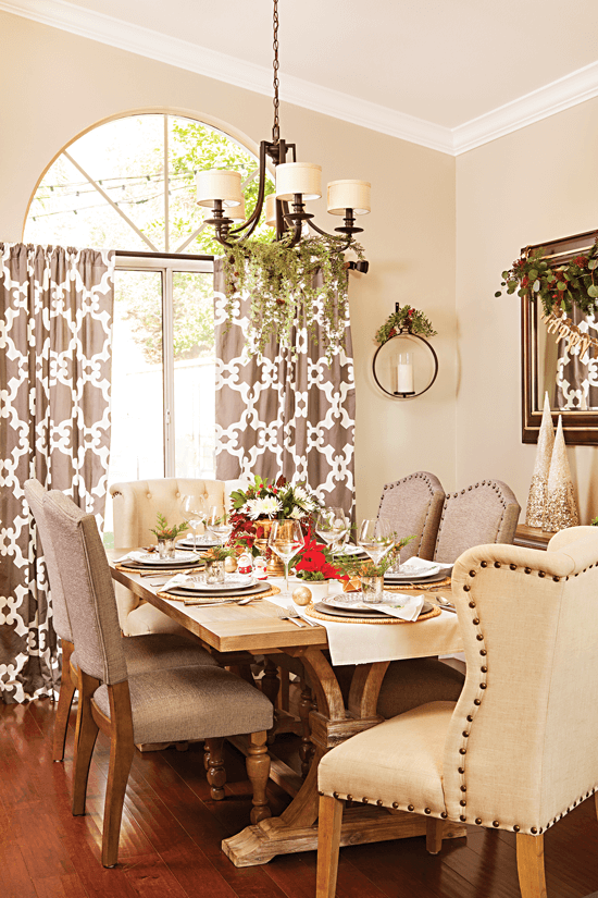 This elegant dining room is decorated with accents of red and green. The overall room décor is simple, which draws the eye towards the detailed dining table. // Cottages & Bungalows