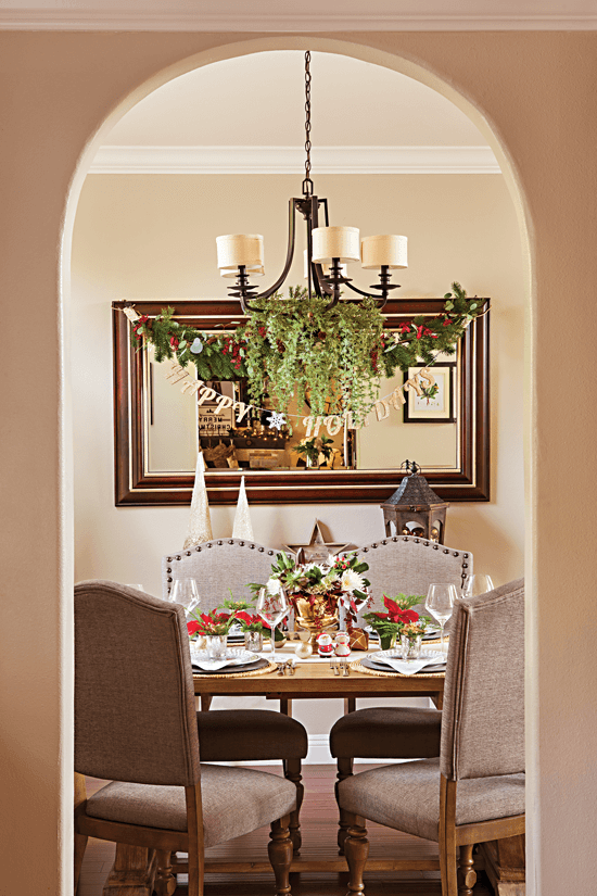 An elegant Christmas dinging area shown through an arched entryway. // Cottages & Bungalows