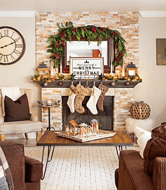 This farmhouse-style Christmas mantel is decorated with simple greenery, wood ornaments, deer antlers and neutral colors for a warm and inviting look. // Cottages & Bungalows