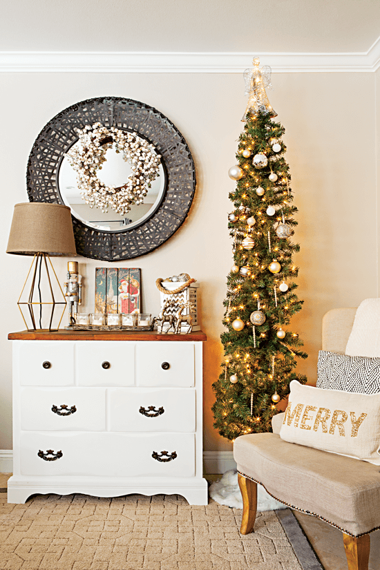 A skinny Christmas tree is used in this space to create dimension and visual interest—decorated with simple old white ornaments, it matches her refinished dresser. // Cottages & Bungalows
