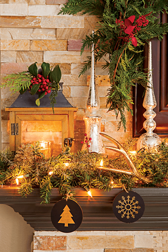 This fireplace mantel is decorated with simple greenery, deer antlers and wood ornaments, giving it a warm and rustic feel. // Cottages & Bungalows